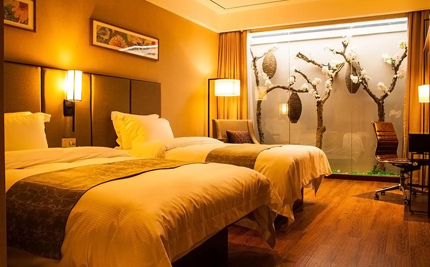 宾馆一个房间的投资普通人可以承担吗?